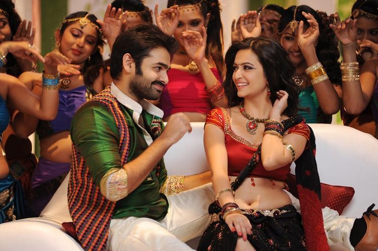 Ram And Kriti Smiling Still From Ongole Gittha Movie