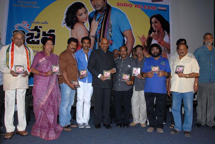 Shobha And Srihari Show The Audio CD At Vishwa Vijetha Movie Audio Launch