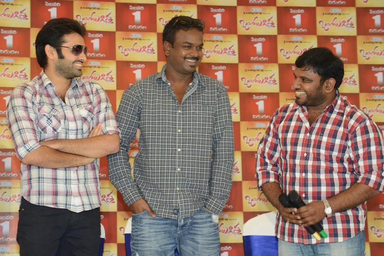 Director Bhaskar And Ram Smiling Still At Ongole Gitta Movie Press Meet
