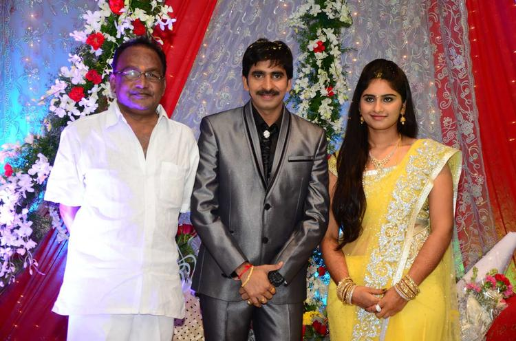 Gopichand With Wife And A Guest Pose For Camera At His Wedding Reception At Avasa Hotel