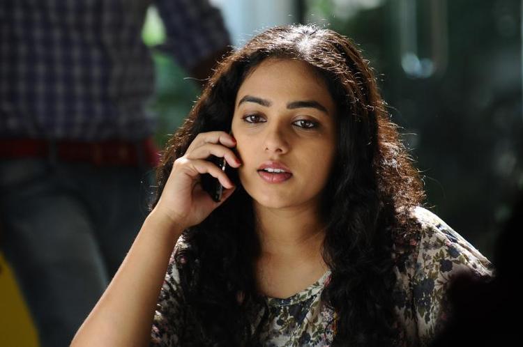 Nithya  Cute Look Photo Still From Movie Gunde Jaari Gallanthayyinde