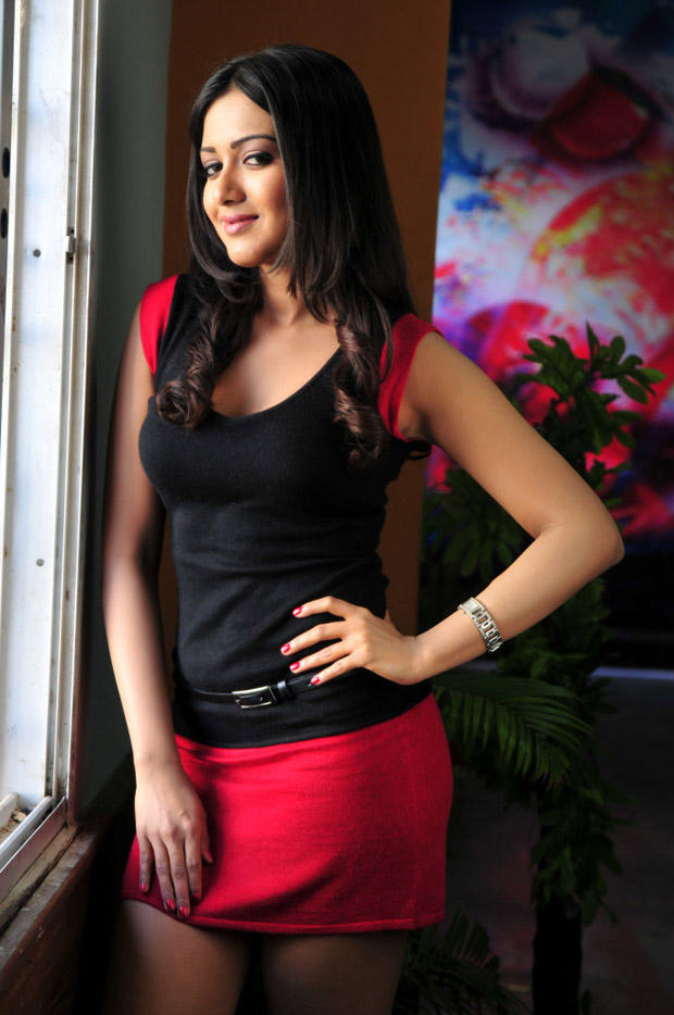 Katherine Hot Photo Still In A Sleeveless Top And Mini Red Scott From Movie Chammak Challo