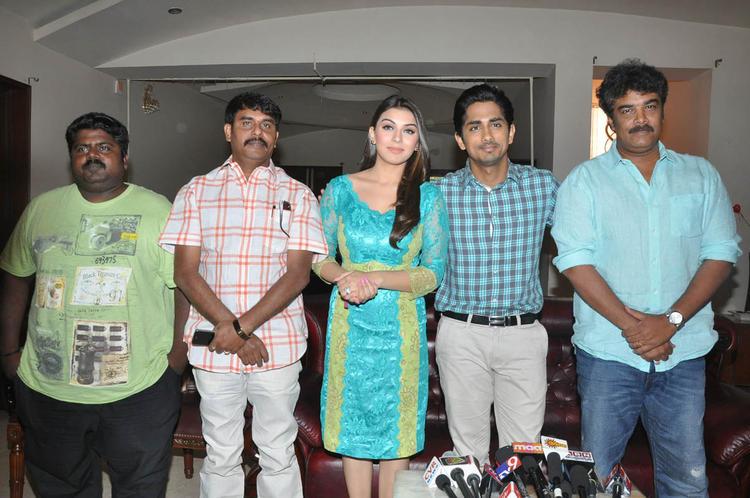 Hansika,Sundar C And Siddharth Posed For Camera At Something Something Movie Press Meet