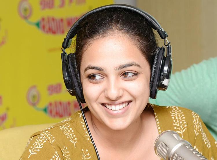 Nitya Menon Cute Smiling Photo Still At Radio Mirchi