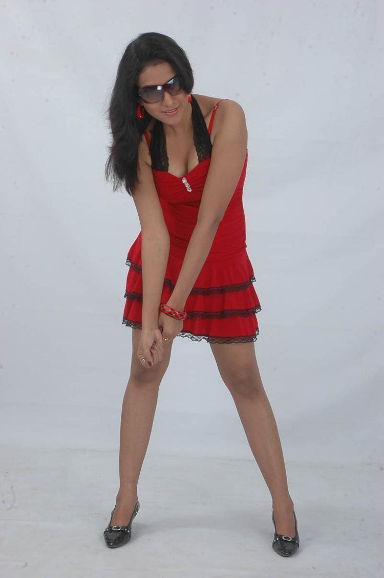 Ujjaini Sexy Look Photo Still In A Red Mini Dress From Movie Lavvata