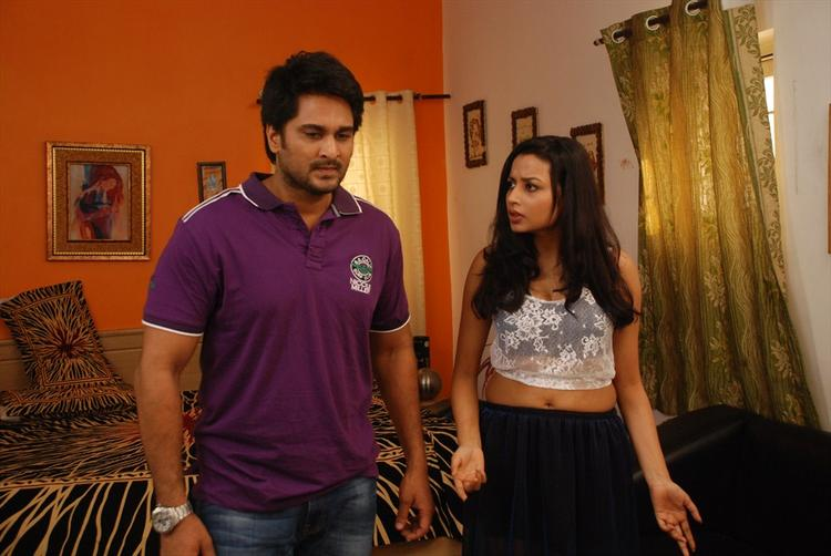 Rishi And Richa Sinha Chatting Still From Srimati Bangaram Movie