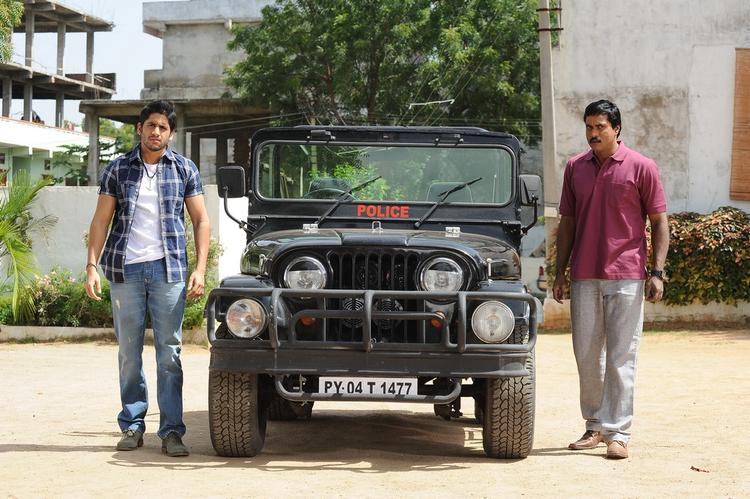 Naga Chaitanya And Sunil Varma A Still From Thadaka Movie
