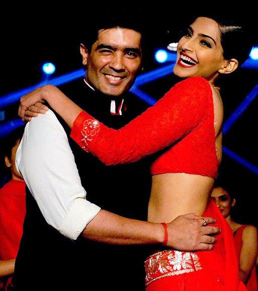 Sonam And Designer Manish Smiling Look On Ramp At Colgate Visible White Launch Event