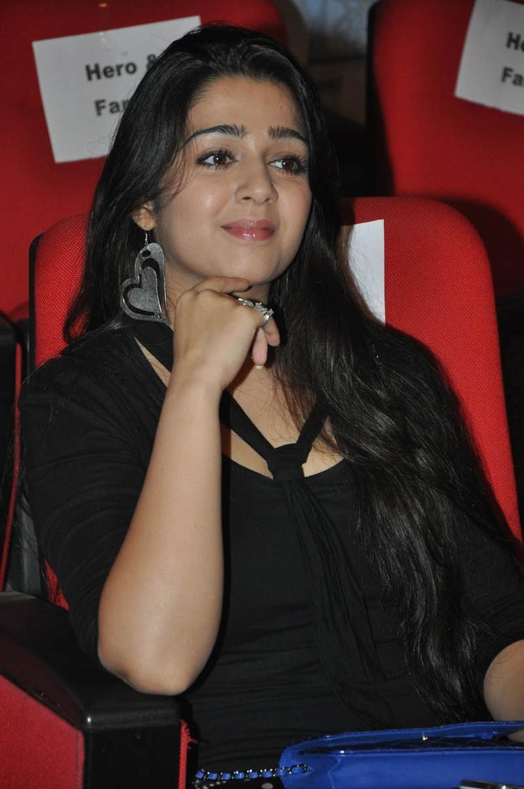 Charmy Kaur Cute Smiling Look At Iddarammayilatho Audio Launch Function