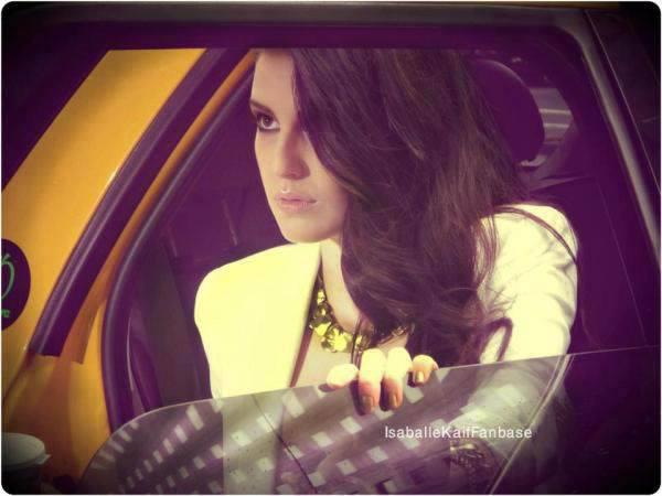 Isabelle Kaif Nice Hot Pic In A Yellow Car