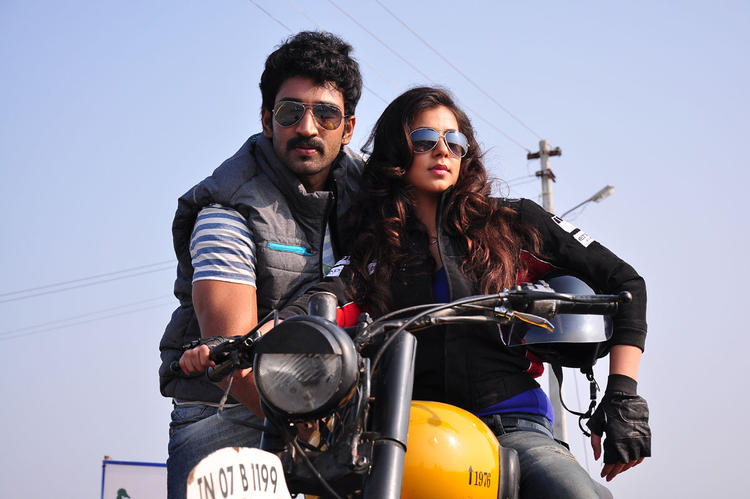 Aadi And Nikitha Latest Still On Bike From Aadi Pinisetty Movie