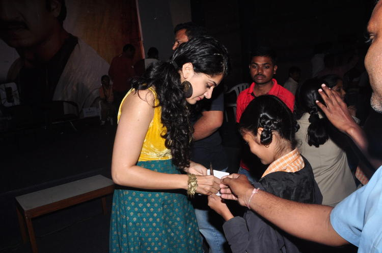 Taapsee Autograph Still At In Sahasam Show To School Students