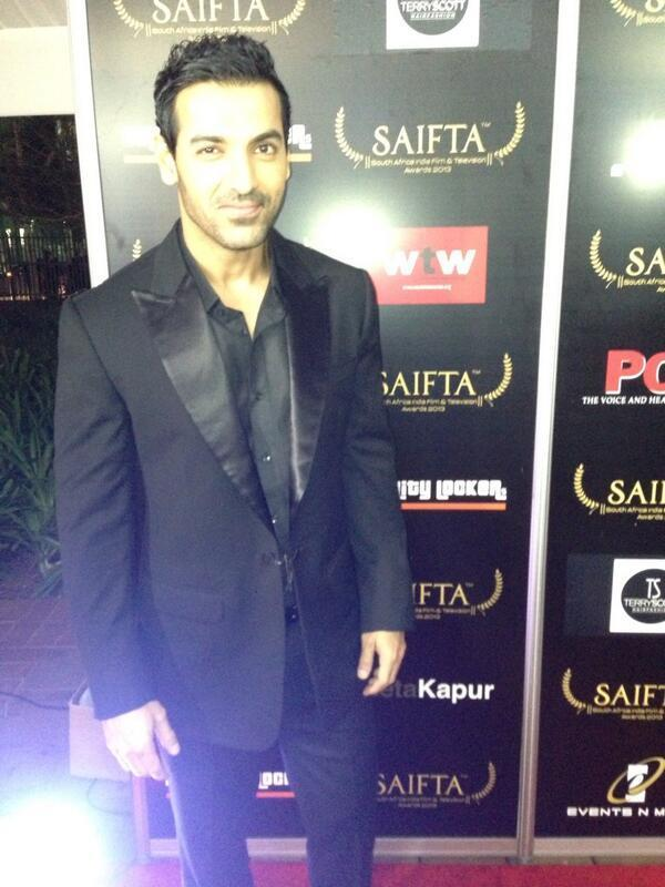 John Abraham Dazzling Look In Red Carpet At The SAIFTA Awards 2013 In Durban