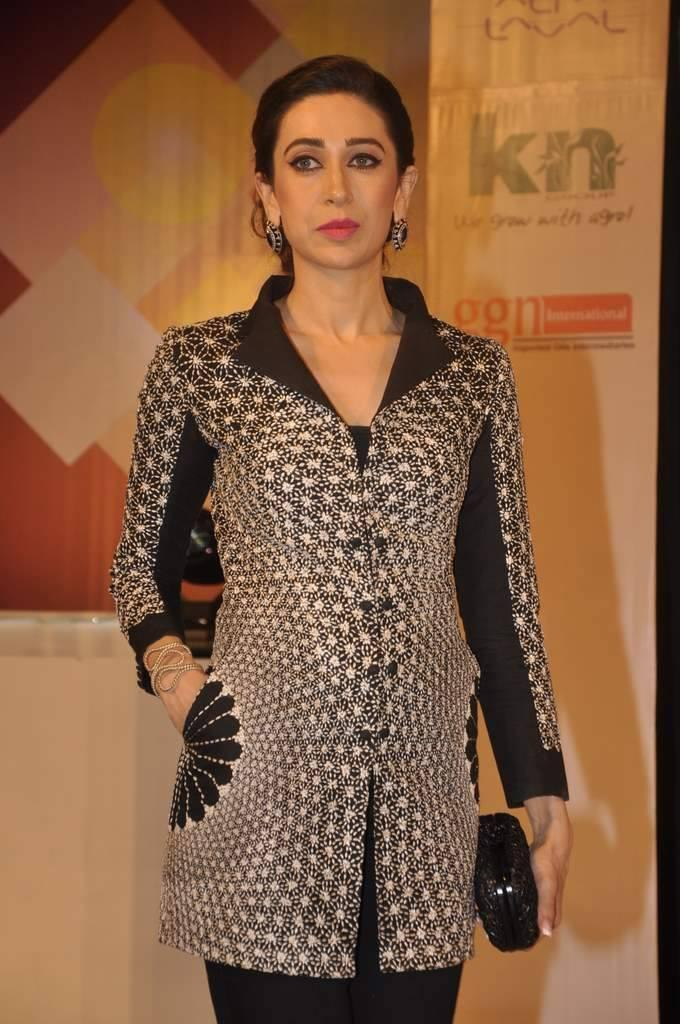 Karisma Looking Beautiful In Her Favourite Black And White Colours Dress At Globoil Awards 2013