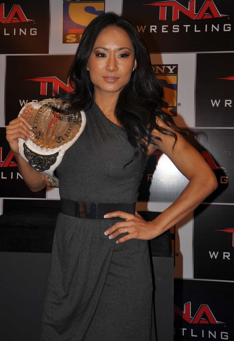Gail Kim Posed For Camera With Her Wrestling Belt At The Sony Six And TNA Press Conference