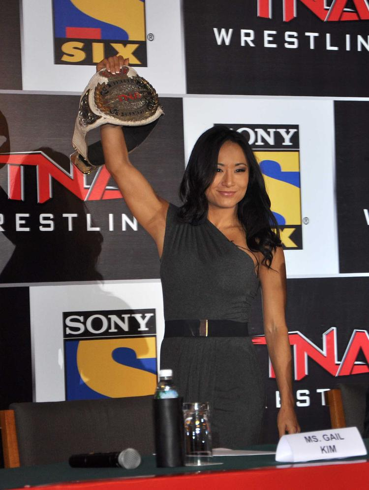 Gail Kim Shows Her Wrestling Belt During The Press Conference For Sony Six And TNA
