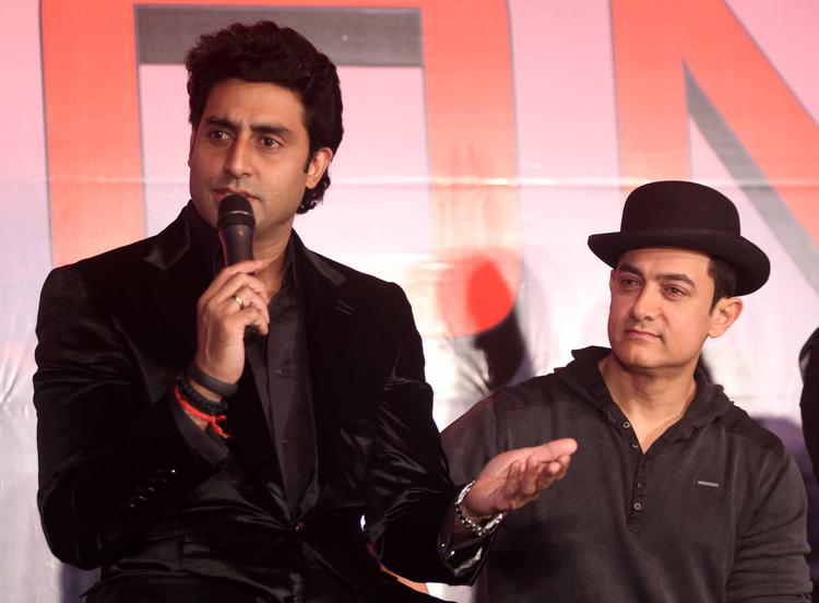 Abhishek Addresses The Media And Aamir Looks On During The Dhoom 3 Press Conference