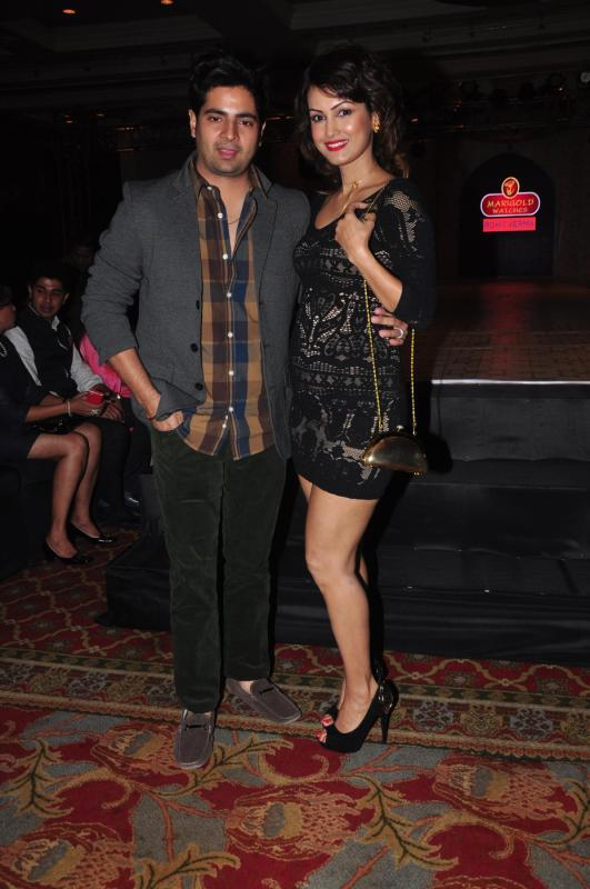 Small Screen's Dancing Couple Karan And Wife Nisha Posed For Lenses At Rohit Verma Marigold Watches Fashion Show 2013