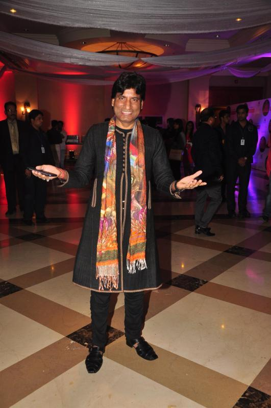 Stand Up Comedian Raju Srivastav Strikes A Pose At Rohit Verma Marigold Watches Fashion Show 2013