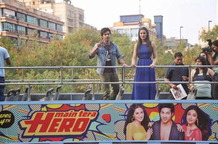Varun Dhawan And Nargis Fakhri Promote Their Film Main Tera Hero By Riding A Open Bus For Visitng Colleges