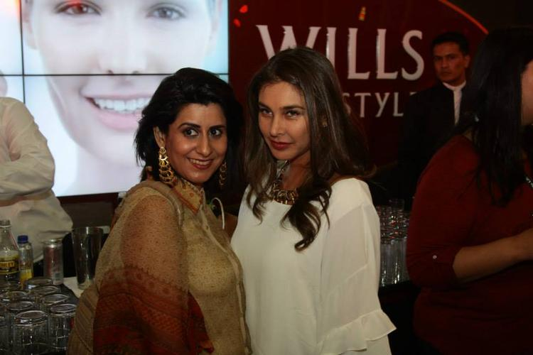 Guests Are Posed At WLIFW Autumn Winter 2014