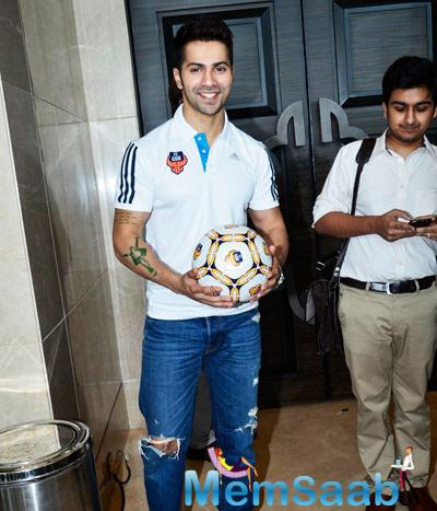 Varun Dhawan Smiling Pose With Football At FC Goa Official Jersey Launch Event