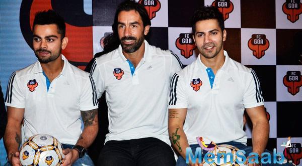 Virat Kohli,Robert Pires And Varun Dhawan Clciked During The Jersey Launch Of FC Goa