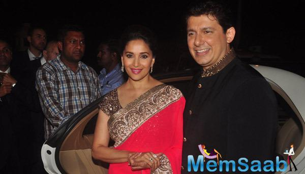 Madhuri Pose With Her Hubby During The Sanjay Hinduja's Pre-Wedding Bash