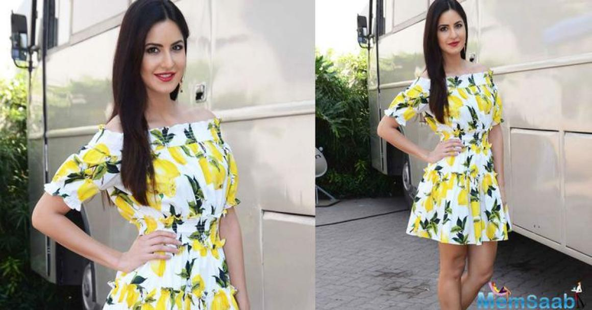 Katrina wore a short lemon print off shoulder dress from Dolce and Gabbana