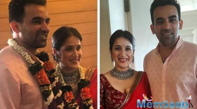 With garlands around their necks, the newly married couple are all smiles for the camera.