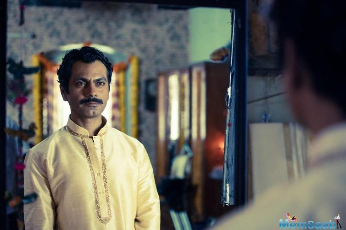 Nawazuddin, dressed in a wedding sherwani, appears to be proud of something he did while he stares into the mirror.