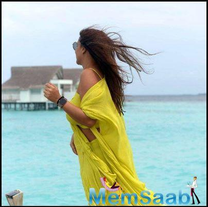Neha Dhupia is chilling by the seashore in the Maldives and she seems carefree away from her hectic daily routine in Mumbai.