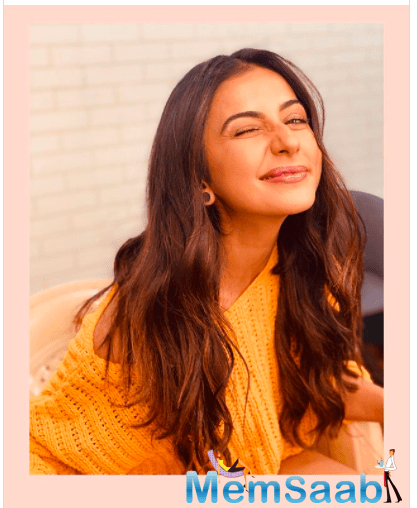 """The 'De De Pyaar De' actress shared an alluring picture of herself where she is seen winking and smiling for the camera. She further captioned it as, """"Winking away at Monday blues  #workmode #gratitude #goofball""""."""