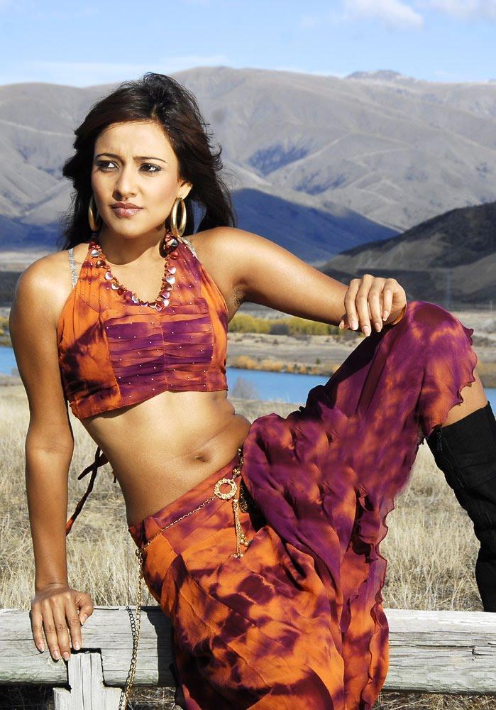 Neha Sharma Sexy Navel Exposing Photo Shoot