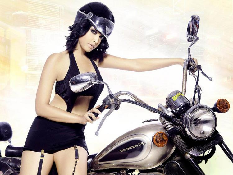 Tanushree Dutta In Bike Sexy Pose Wallpaper