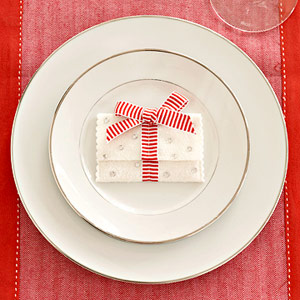 white holder with red bow