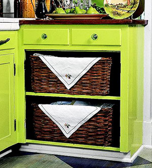 baskets on lower shelves, green painted cabinets