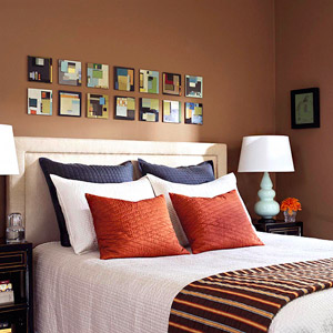 brown bedroom with blue pillows