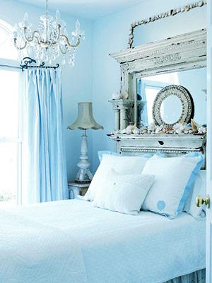 blue bedroom with chandelier