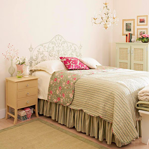 girly bedroom with painted headboard