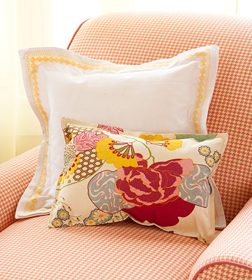 two pillows on red checked chair