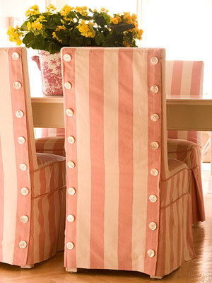 Floor-length slipcovers dress up dining room chairs