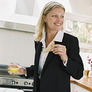 Woman eating before work