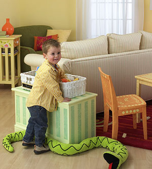 child putting away toys