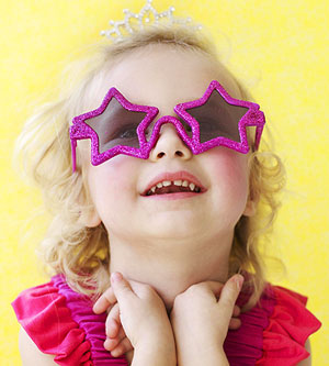 toddler wearing star sunglasses
