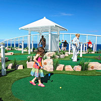 child playing mini golf on Oasis of the Seas Western Caribbean Cruise