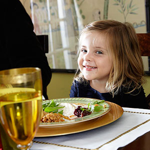 child at dinner table