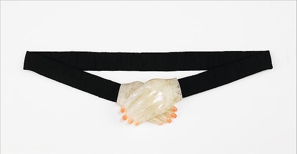 Evening belt Elsa Schiaparelli  (Italian, 1890–1973)  Date:     fall 1934 Culture:     French Medium:     silk, plastic Dimensions:     Other: 29 in. (73.7 cm)