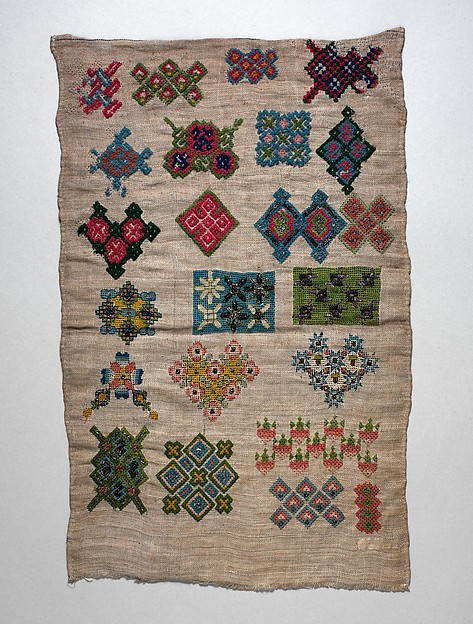 Sampler with geometric motifs