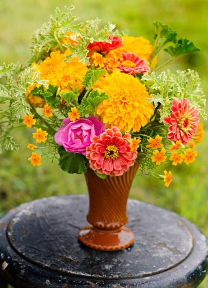 7 Gorgeous Ways to Show Off Your Marigolds   Midwest Living Collect marigold heads of as many sizes and varieties as you like  then sew  them together with a needle and thread to create a gorgeous floral garland